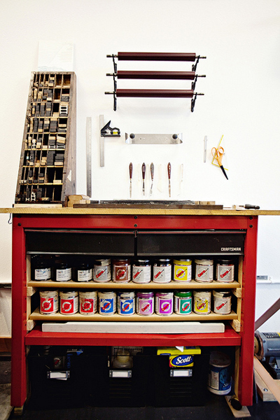 Letterpress work bench with ink and cleaning supplies