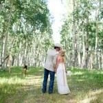 The Bride and Groom Kiss in the Forest