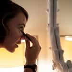 Bride putting on mascara in mirror