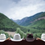 Cowboy Hats on a Railing