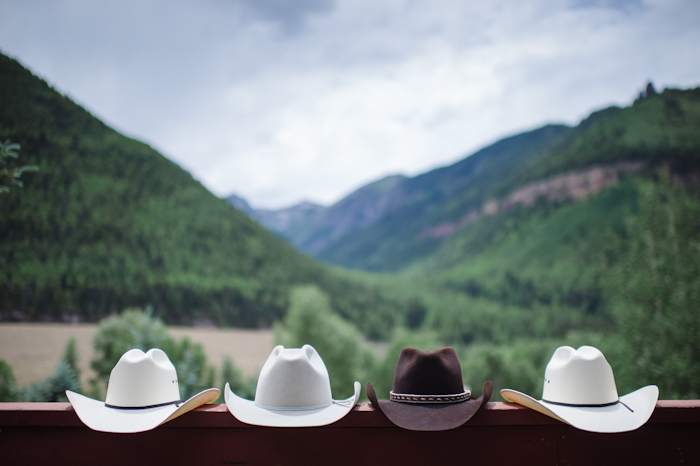 Cowboy Hats on a Railing